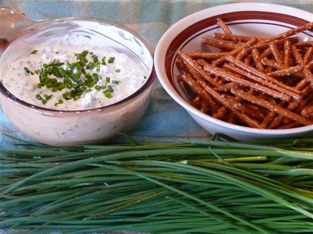 Chive dip, pretzels and fresh chives.